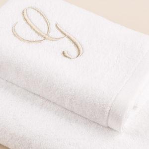 Coppia spugna bianca con cifra ricamata colore sabbia